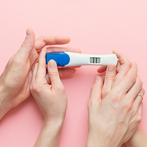 pregnancy-test-with-positive-result-and-clothing-f-PRLJFEC